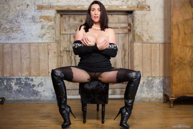 Glass dildo wank, Miss Hybrid ripped pantyhose and leather thigh boots in the dungeon.