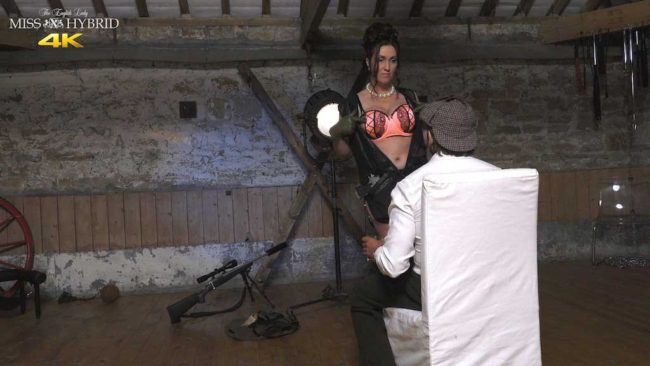 Strict boss and lady of the Manor Miss Hybrid leather boots and stocking tops.