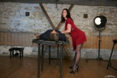 Miss Hybrid sexy nylons and high heels tit wank in the manor dungeon.