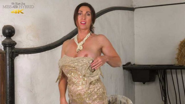 Miss hybrid sexy gold dress big tits playing with nipples.